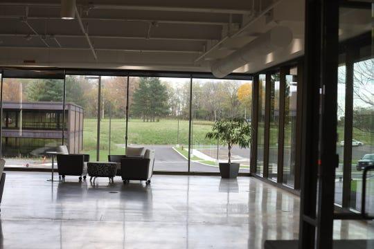 Walls of windows greet visitors to eLogic at Riverwood Tech Campus.