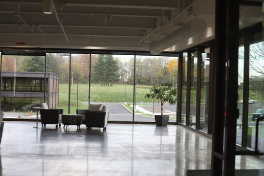 Walls of windows greet visitors to eLogic at Riverwood Tech Campus.