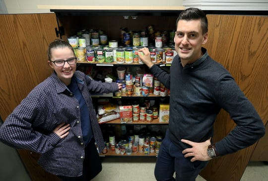 Webster Schroeder senior Taylor Coonelly and school psychologist Joe Jackson have created a makeshift food pantry in the school.