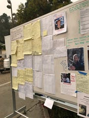 About 300 names are written on this board. It's set up on the grounds of The Neighborhood Church in Chico, the location of an evacuation center for people displaced by the Camp Fire. Nov. 13, 2018