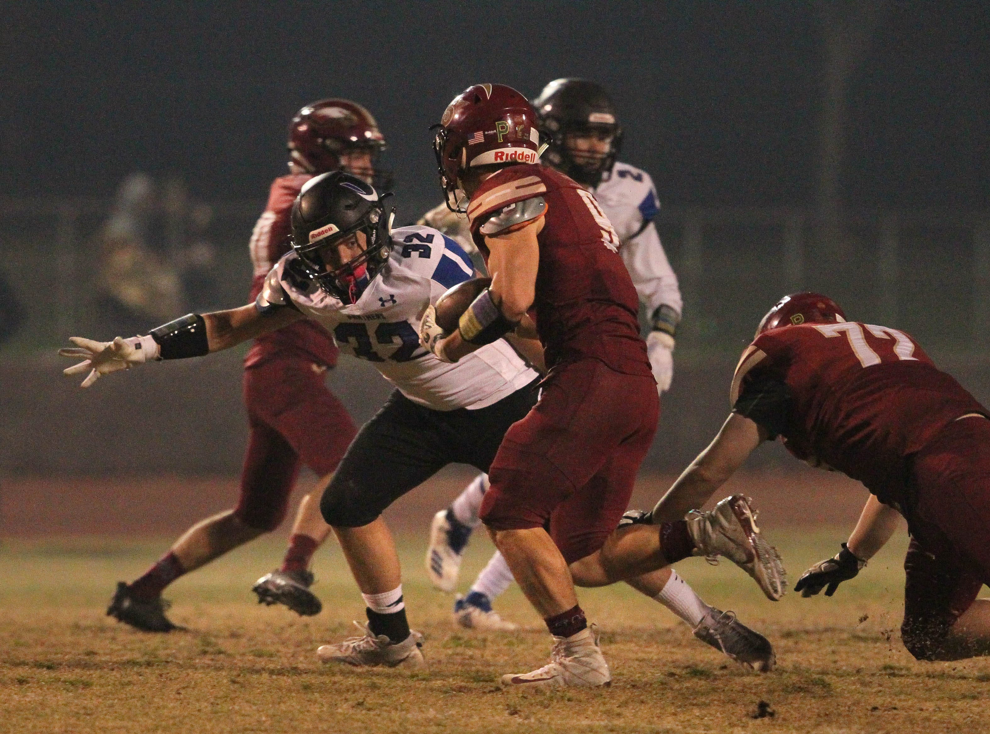U-Prep's  Jacob Reuss (32) looks to make a tackle on West Valley's Cade Lambert (9) in the 2nd quarter on Friday, Nov. 9.   The Eagles defeated the Panthers, 55 -6, at home to advance to the 2nd round against Lassen on Nov. 16.
