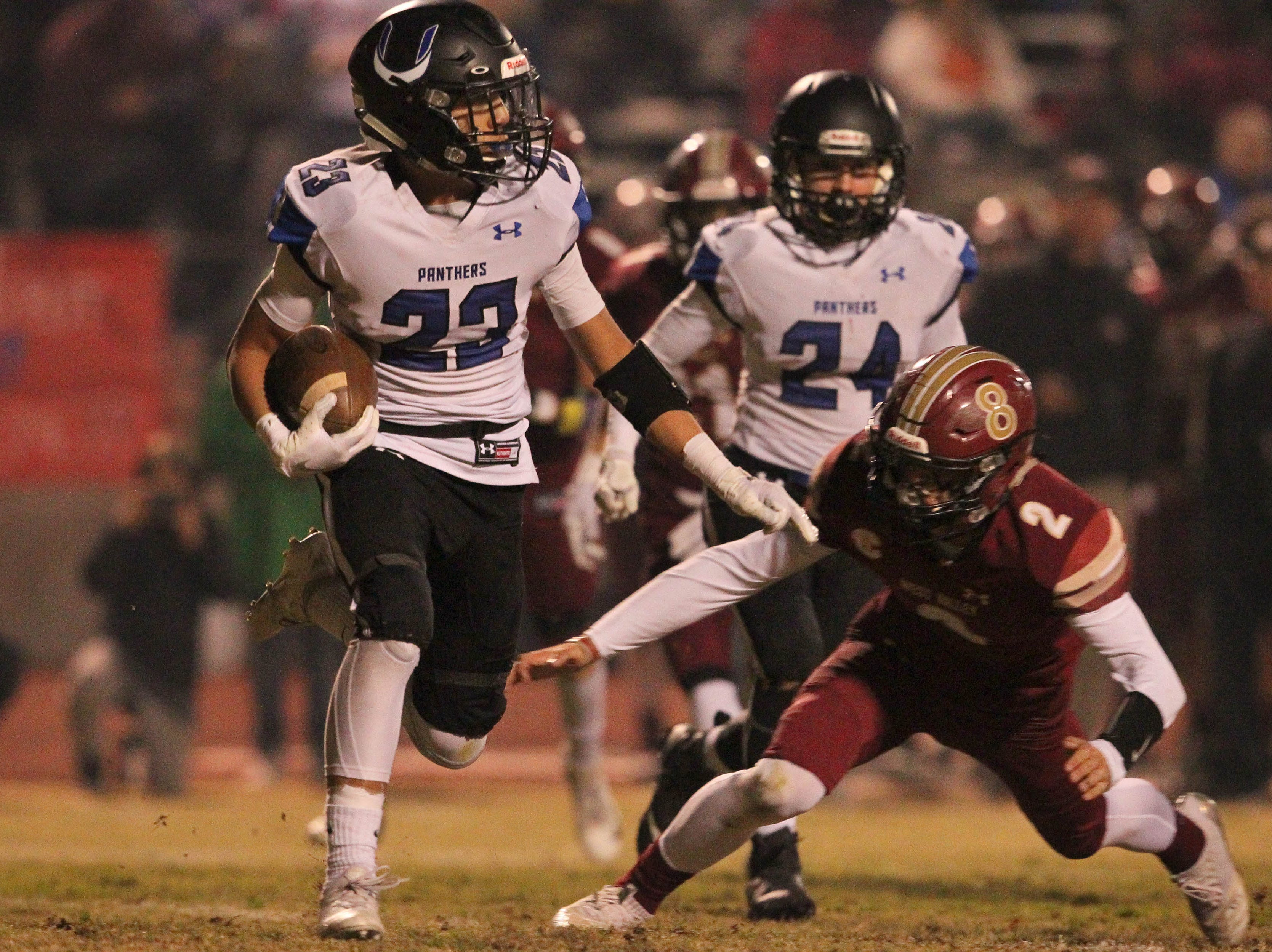 U-Prep WR, Kaden Jones (23) tries to run for a 1st down against West Valley's Devin Low (2) in the 1st quarter on Friday, Nov. 9.  The Eagles defeated the Panthers, 55 -6, at home to advance to the 2nd round against Lassen on Nov. 16.