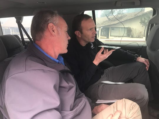 U.S. Interior Secretary Ryan Zinke, left, and FEMA Administrator Brock Long speak with President Donald Trump from Paradise, California in the wake of the Camp Fire in this Wednesday, Nov. 14, 2018 handout photo.