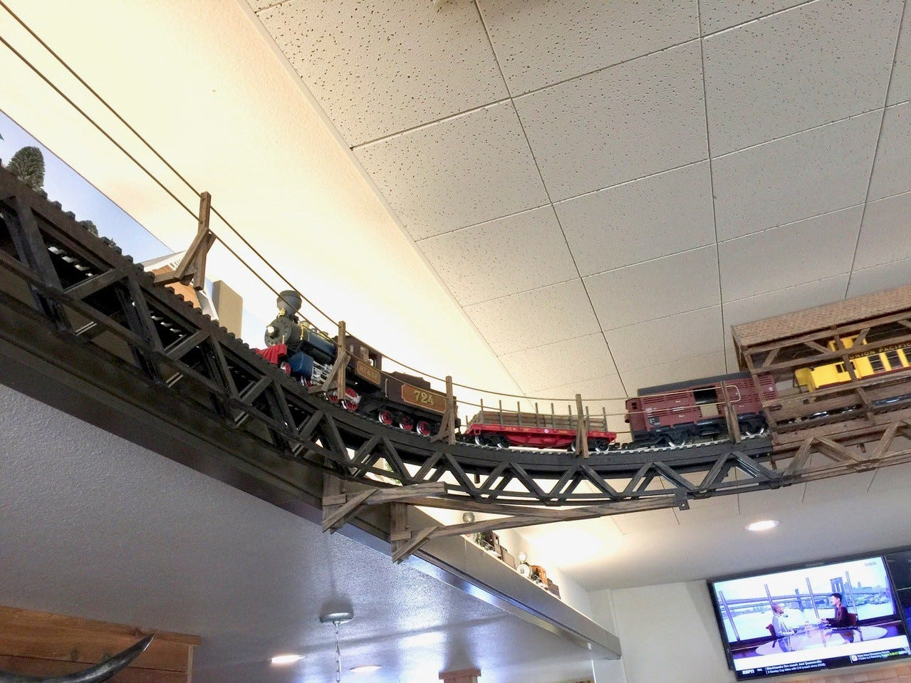 A fun feature of Jeff's California Cattle Company is this model train,  which circles on tracks above the dining room.