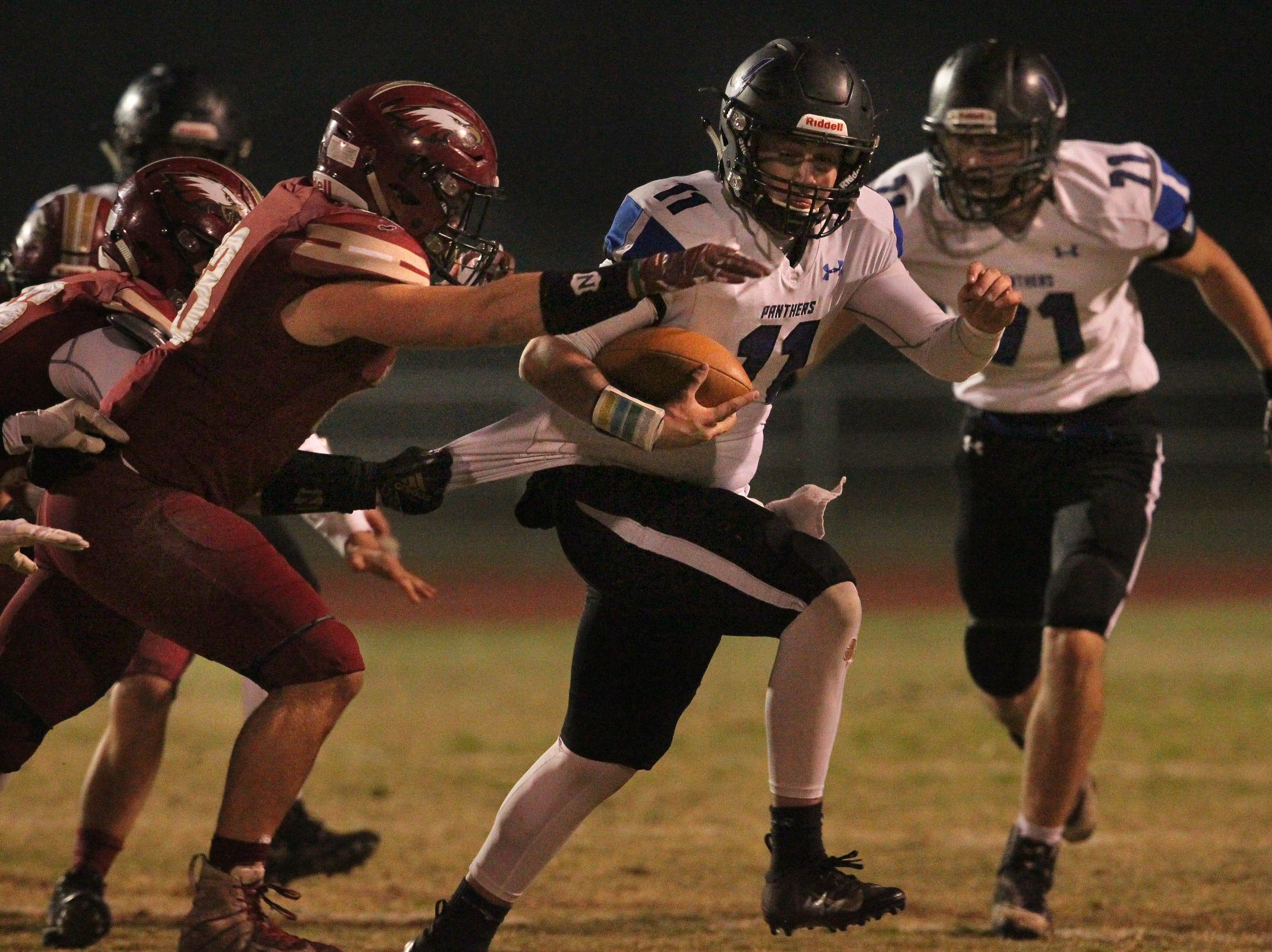 U-prep QB Dylan Cabral (11) tries to break away from West Valley defense on Friday, Nov. 9  The Eagles defeated the Panthers, 55 -6, at home to advance to the 2nd round against Lassen on Nov. 16.