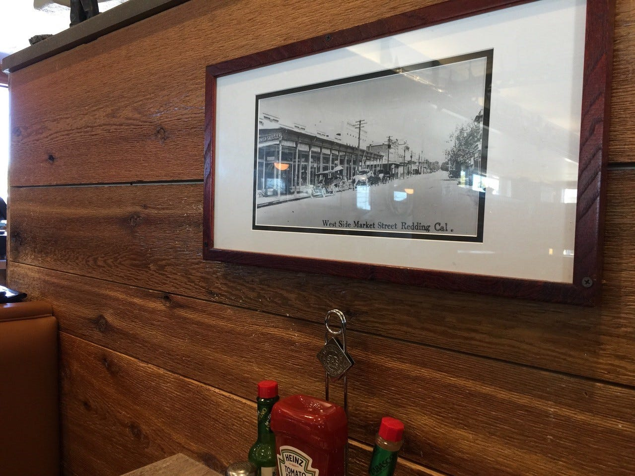Decor at Jeff's California Cattle Company includes framed black and white photos of old Redding.