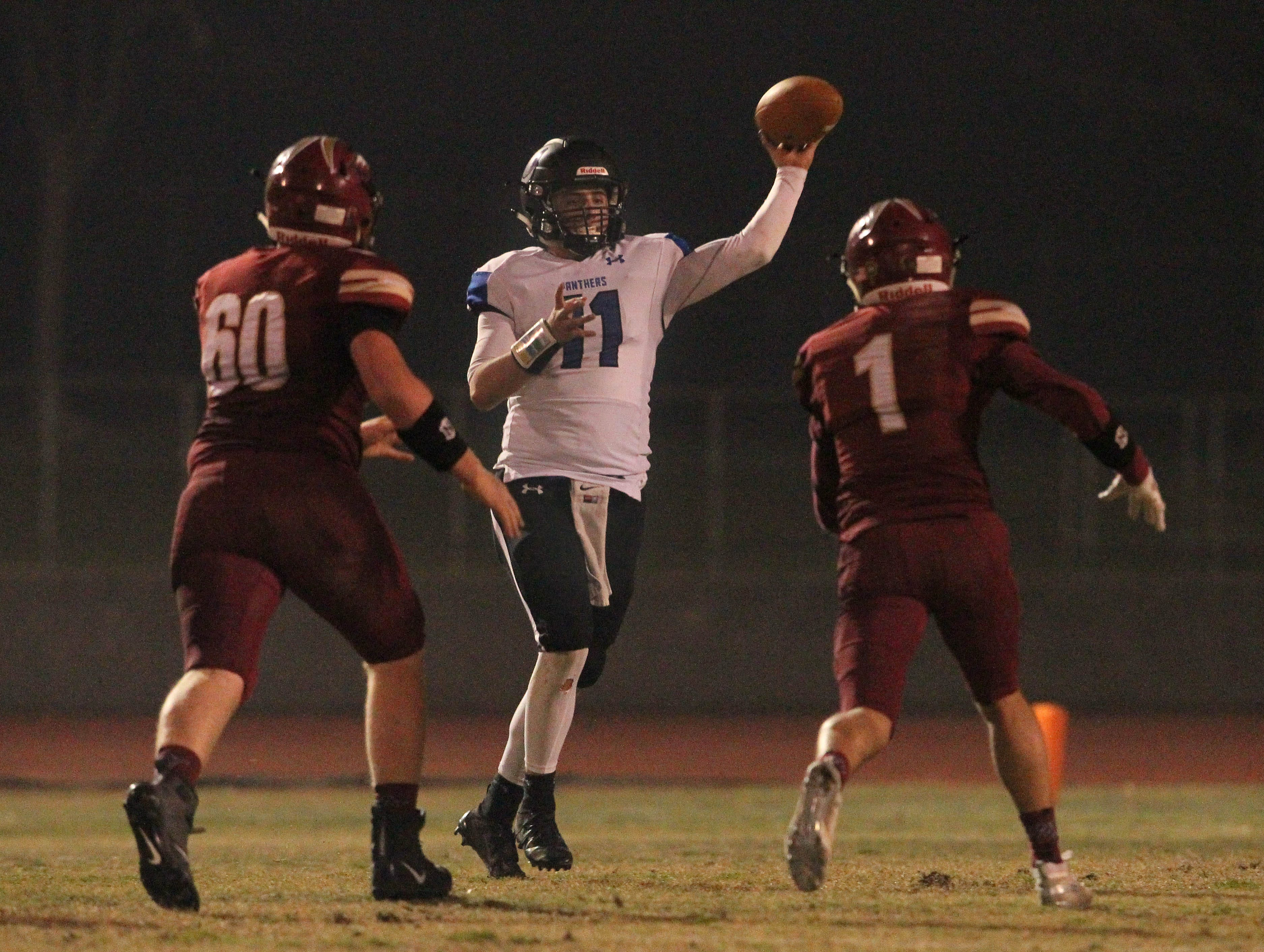 U-Prep QB Dylan Cabral (11) looks to pass the ball over West Valley's Brock Taylor (1) and Logan Gonzalez (60) in the 3rd quarter on Friday, Nov. 9.  The Eagles defeated the Panthers, 55 -6, at home to advance to the 2nd round against Lassen on Nov. 16.