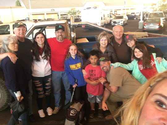 The Nonneman family accounted for in a parking lot in Chico. From left to right Marie LeRossignol, Bill LeRossignol, Brooke Nonneman, Chris Nonneman, Lily Nonneman, Andy Reed, Ben Reed, Patty Nonneman, Tom Nonneman, Nicole Reed and Natalie Reed.