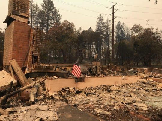 A photo of the Nonneman family home after the Camp Fire in Paradise, Calif. Nothing is left standing of their newly-renovated home save the chimney.