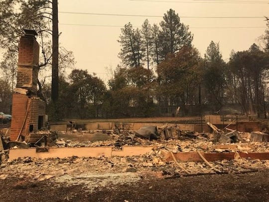 The remains of the Nonneman family home after the Camp Fire hit Paradise. Only the chimney and the outline of the foundation remain of their newly-renovated home.