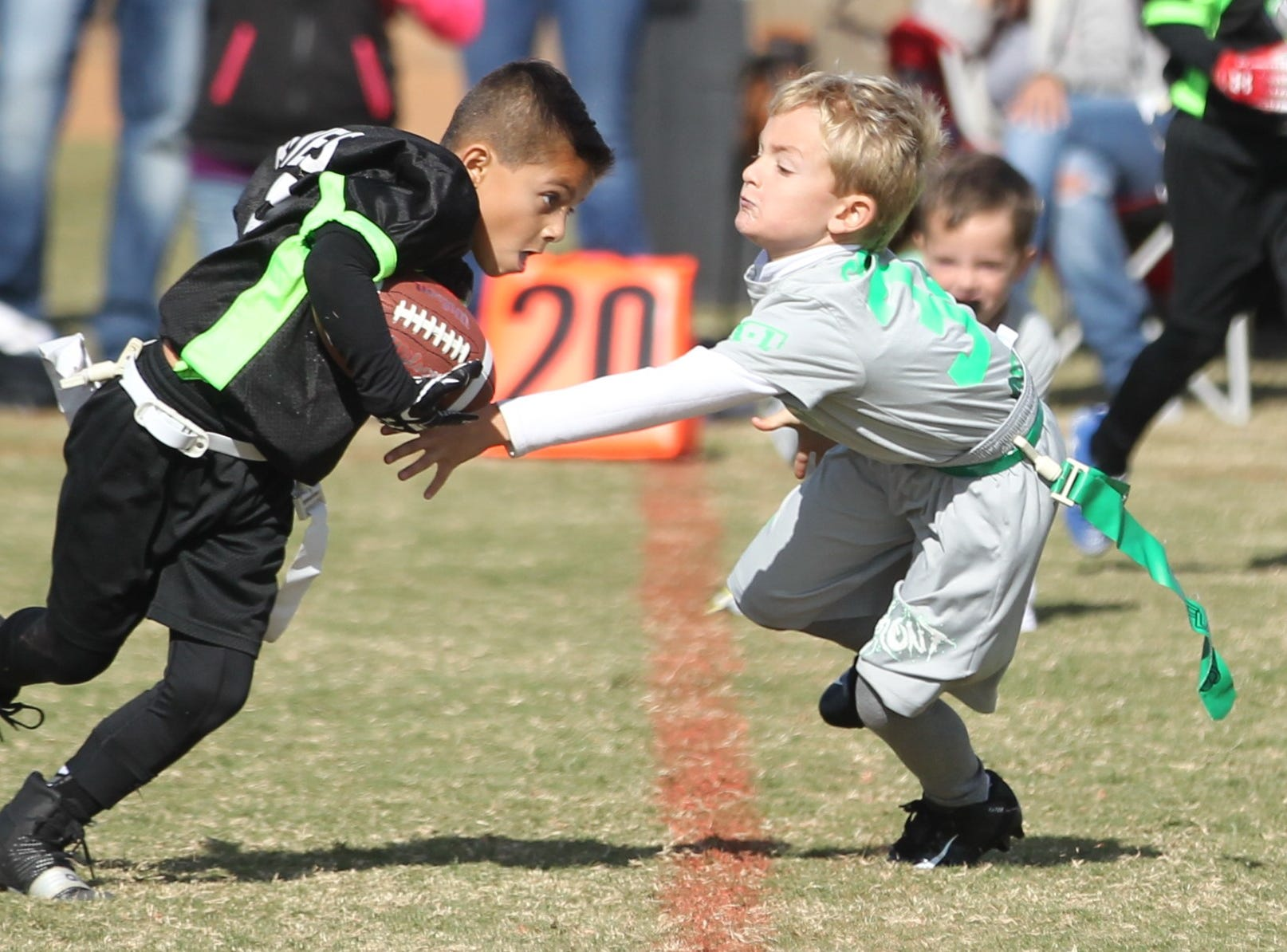 San Angelo Seahawks' Aiden Reyes runs the ball as The Front's Corbyn Odell defends on the play during the championship game of the 6u TAAF State Youth Flag Football Tournament at the Texas Bank Sports Complex on Sunday, Nov. 11, 2018. The Front, which is from Wall, won a defensive battle 13-0.