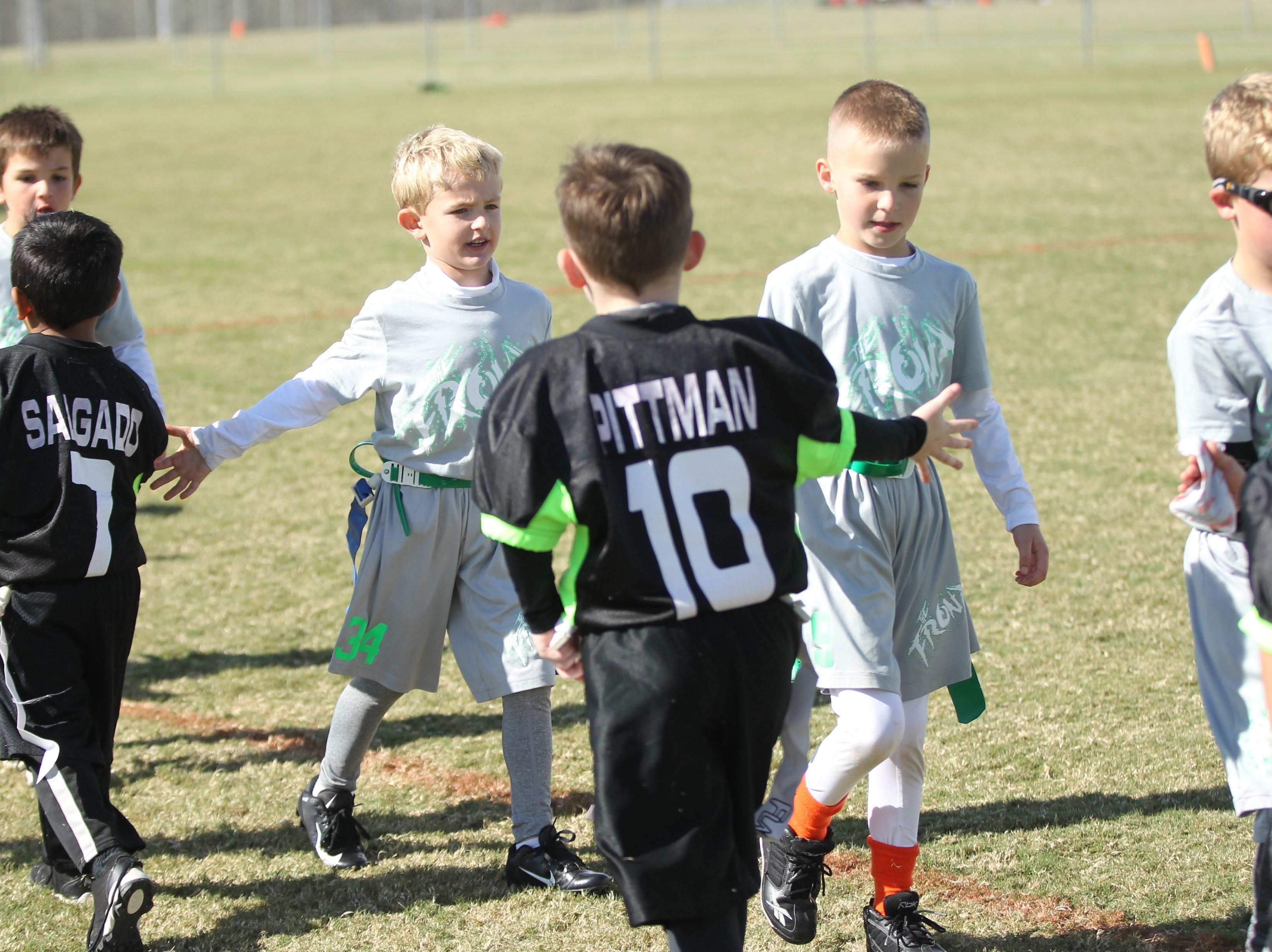 Players for The Front and the San Angelo Seahawks (black uniforms) congratulate each other for a good contest after the championship game of the 6u TAAF State Youth Flag Football Tournament at the Texas Bank Sports Complex on Sunday, Nov. 11, 2018. The Front won a defensive battle 13-0.