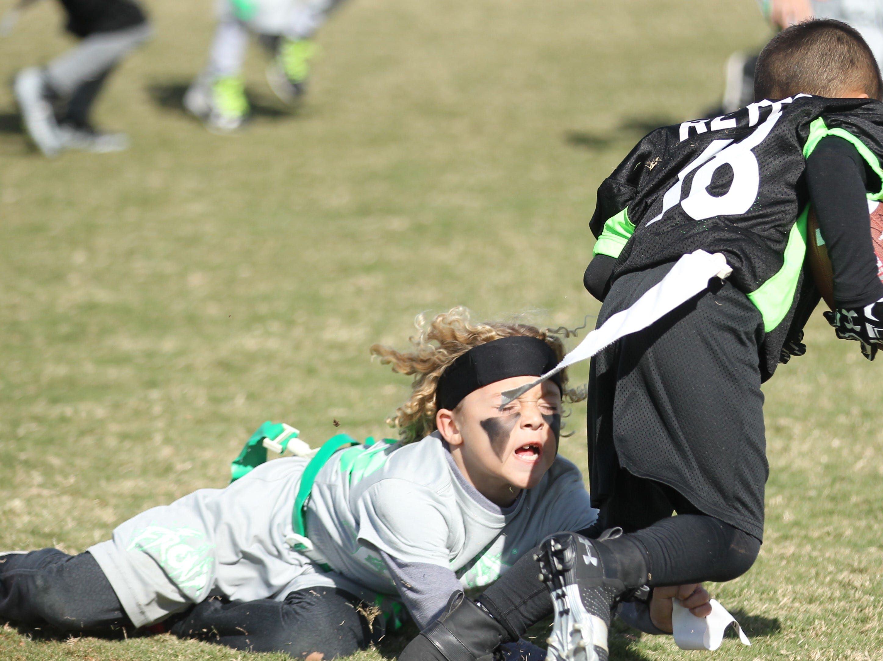 The Front's Trae Chambers goes for the tackle on San Angelo Seahawks' Aiden Reyes during the championship game of the 6u TAAF State Youth Flag Football Tournament at the Texas Bank Sports Complex on Sunday, Nov. 11, 2018. The Front won a defensive battle 13-0.