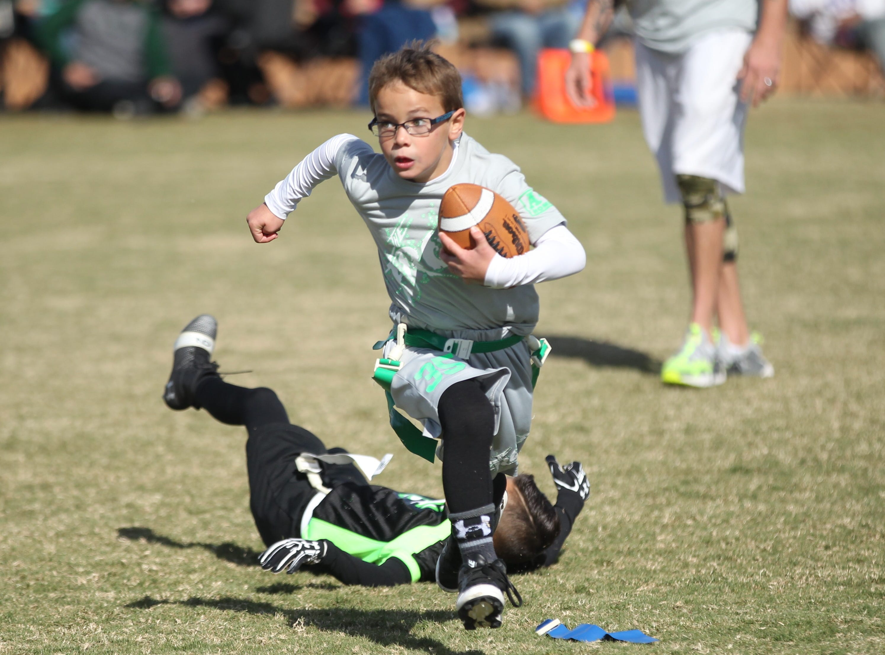 The Front's Barrett Stone gets past a San Angelo Seahawks player during the championship game of the 6u TAAF State Youth Flag Football Tournament at the Texas Bank Sports Complex on Sunday, Nov. 11, 2018. The Front won a defensive battle 13-0.