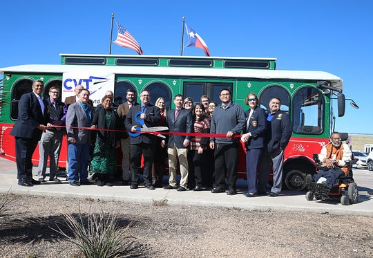 Representatives from Concho Valley Transit and city government pose for a photo during a ribbon cutting Wednesday, Nov. 14, 2018 to celebrate the rebranding of the city's public transportation service.