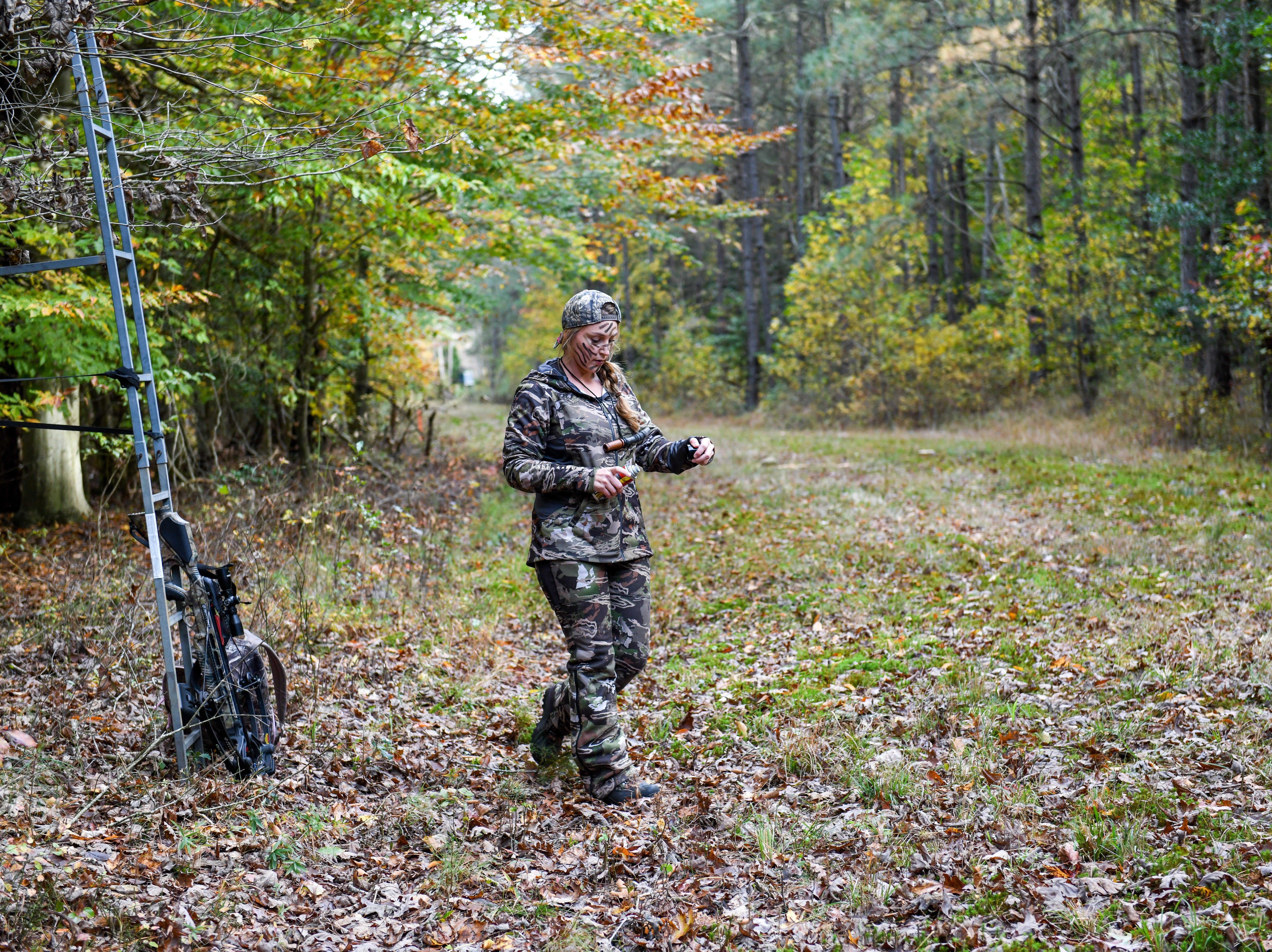 Fidelia Kurtz sprays deer pee around her hunting stand in Snow Hill on Thursday, Nov 8, 2018.