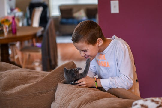 10-year-old Brianna Merritt plays with the family kitten in her Berlin home on Wednesday, Nov 7, 2018.