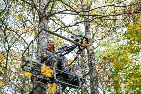 Fidelia Kurtz sits watching for deer in her hunting stand in Snow Hill on Thursday, Nov 8, 2018.