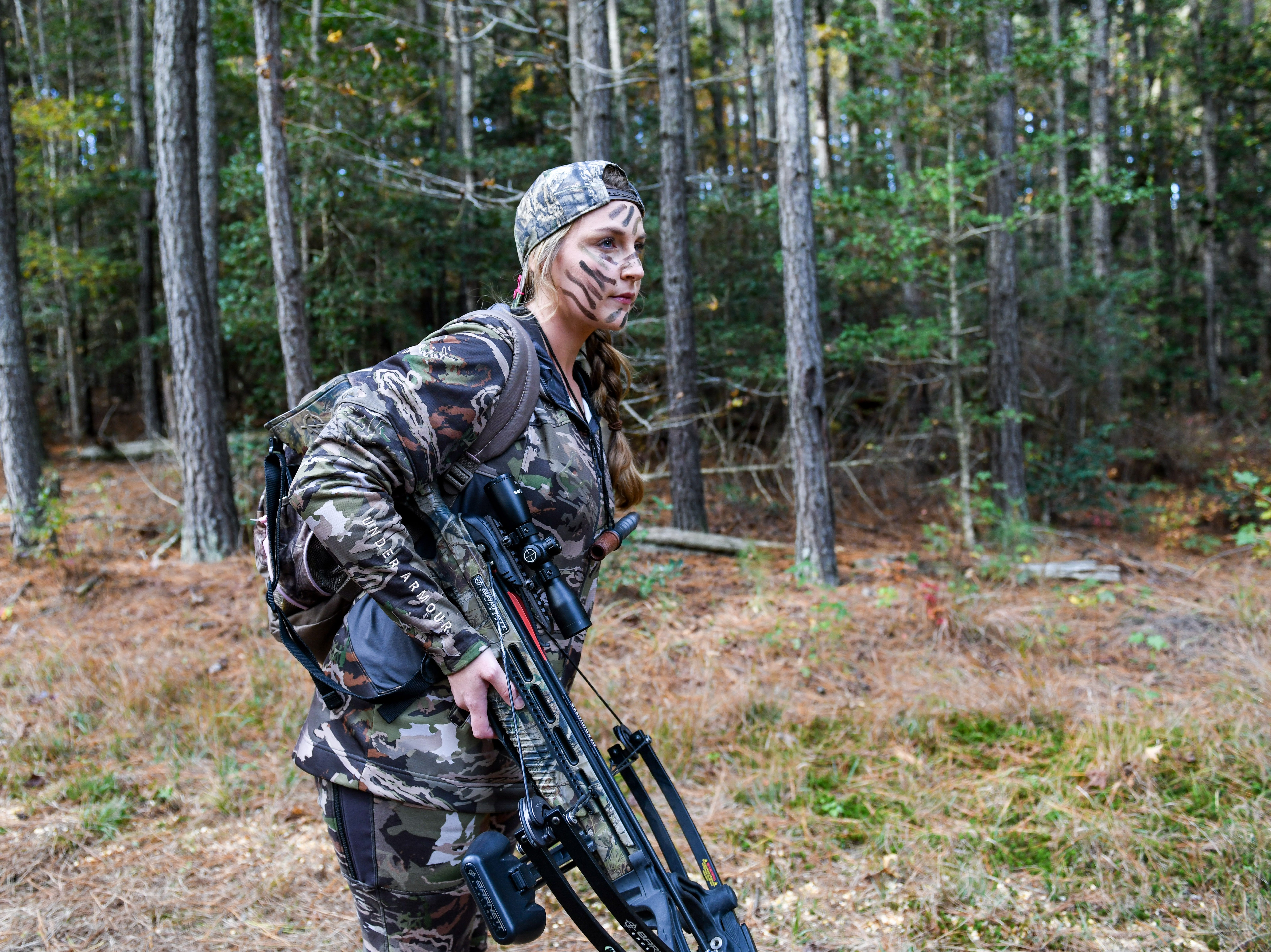 Fidelia Kurtz quietly looks for deer in the woods on the way out to her hunting stand in Snow Hill on Thursday, Nov 8, 2018.