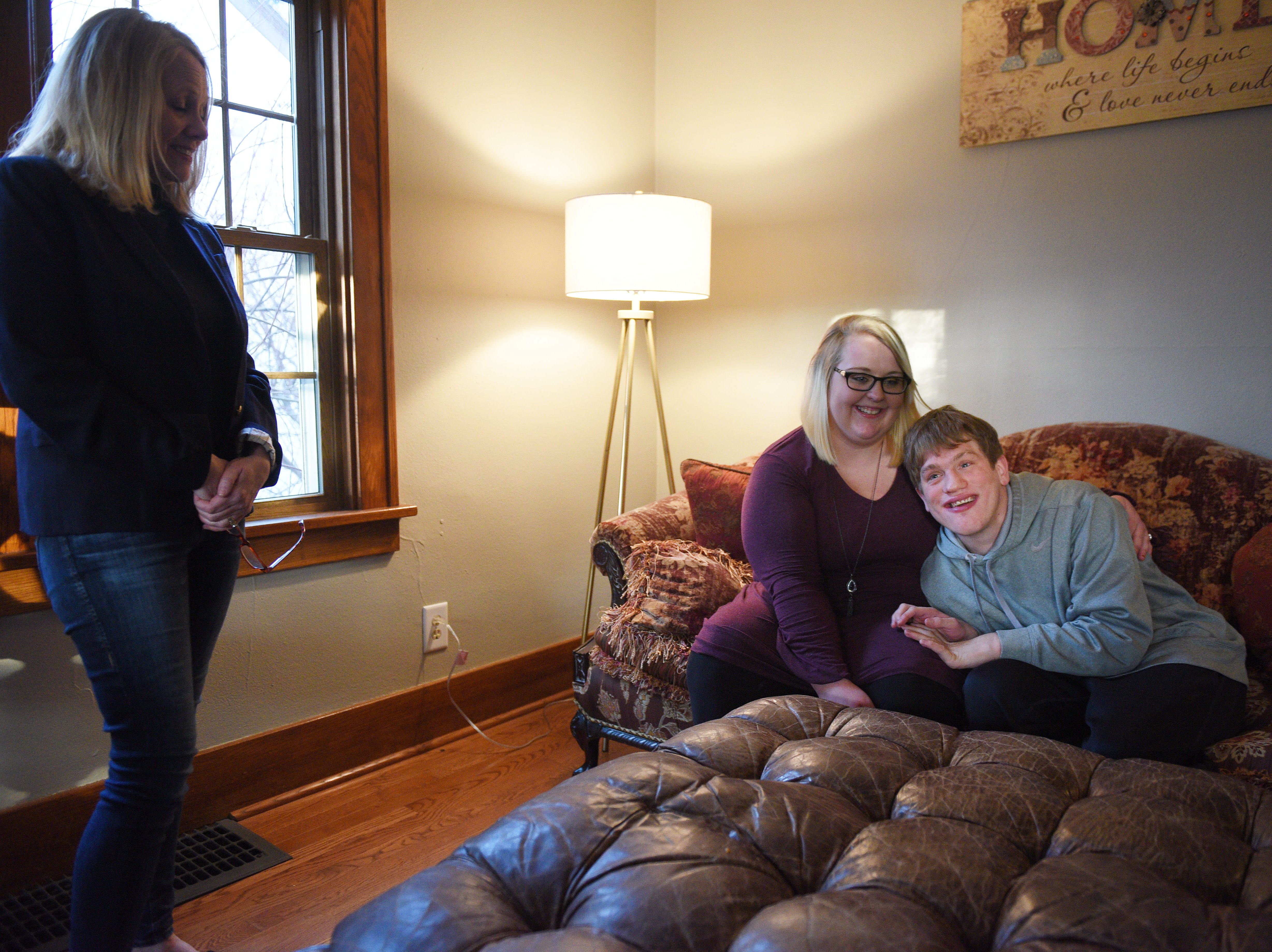Ben Graff hangs out at his new house with his roommate Jenna Askelson and his mom Debbie Graff Wednesday, Nov. 7, in Sioux Falls. He lives with Shared Living Provider Kayla Harris and Askelson.