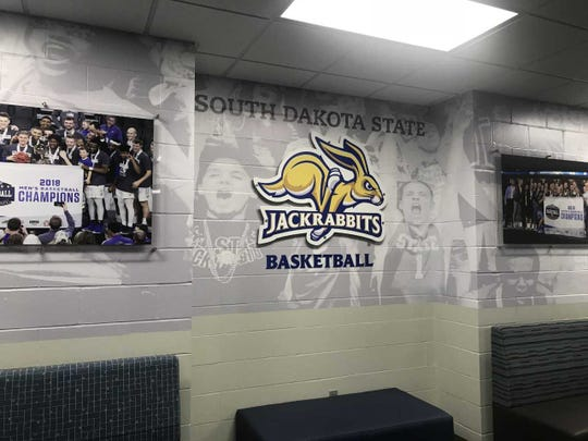 The room between Frost Arena and the practice facility. A door on the left leads to the men's gym, the door on the right to the women's gym.
