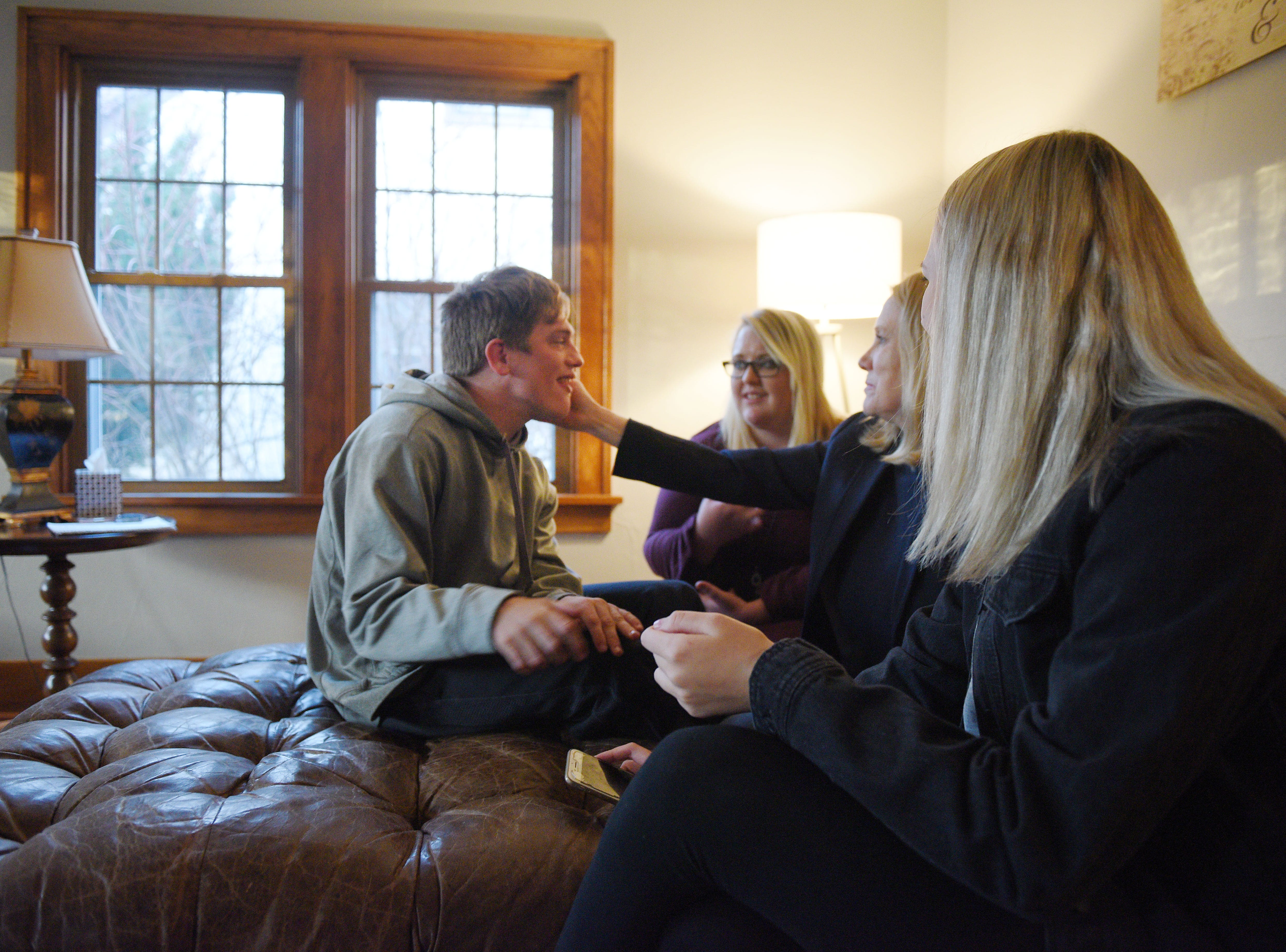 Ben Graff has his family over at his new house Wednesday, Nov. 7, in Sioux Falls. He lives with Shared Living Provider Kayla Harris and roommate Jenna Askelson.