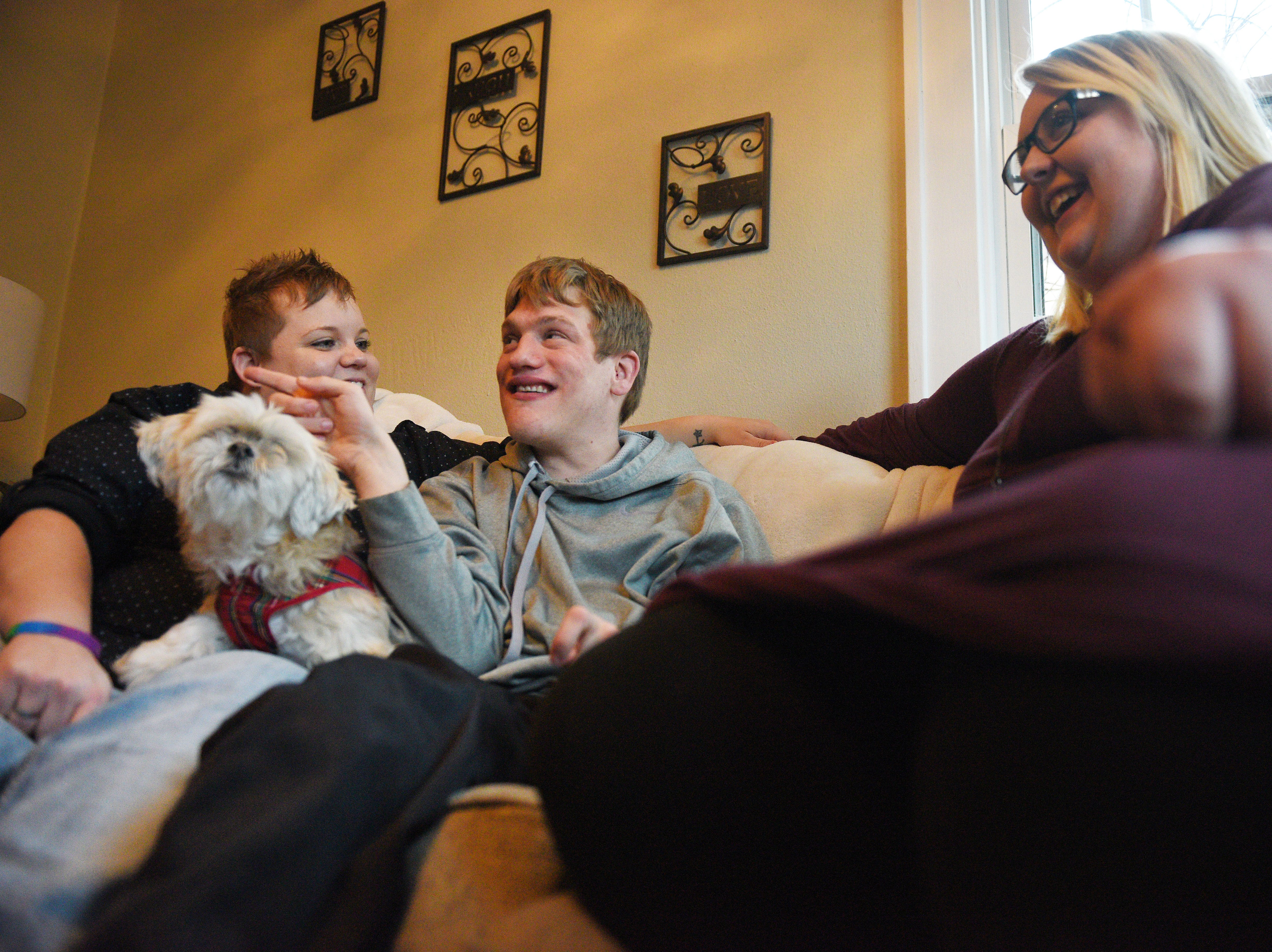 Ben Graff shows how him and his roommates watch tv in their new home Wednesday, Nov. 7, in Sioux Falls. He lives with Shared Living Provider Kayla Harris and roommate Jenna Askelson. Harris' dog, Chu Chi, also lives at the home. Harris and Askelson provide care for Ben daily so that he can live independently from his parents Debbie and Neil Graff.