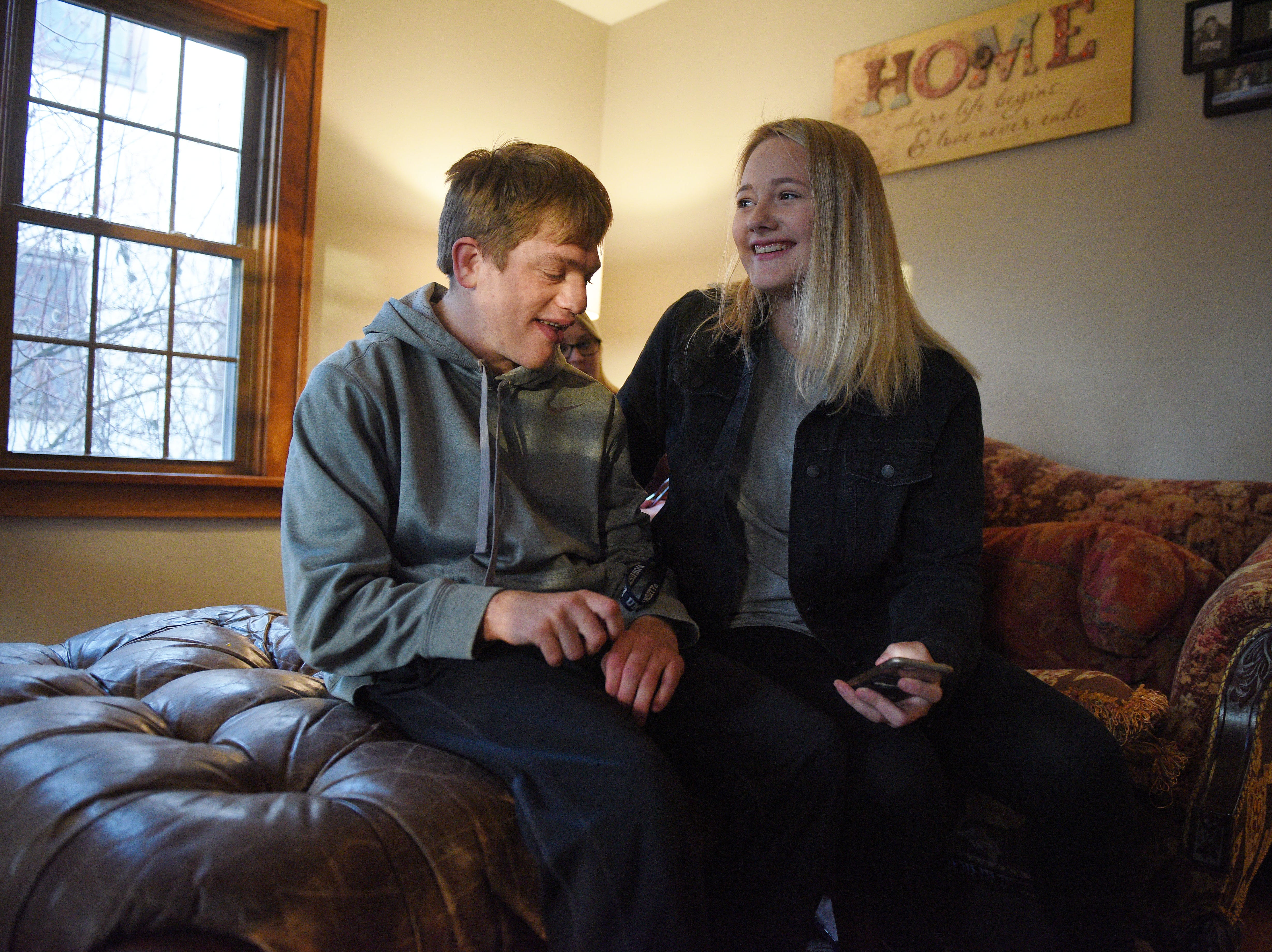 "Elizabeth Graff, who Ben calls ""Lala"" comes by her brother Ben Graff's new house to visit Wednesday, Nov. 7, in Sioux Falls. Ben is able to live by himself with the assistance of Shared Living Provider Kayla Harris and roommate Jenna Askelson."