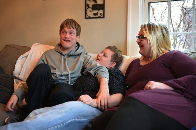 Ben Graff shows how him and his roommates watch tv in their new home Wednesday, Nov. 7, in Sioux Falls. He lives with Shared Living Provider Kayla Harris and roommate Jenna Askelson. The two provide care for Ben daily so that he can live independently from his parents Debbie and Neil Graff.