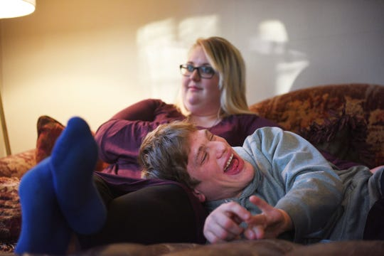 Ben Graff hangs out at his new house with his roommate Jenna Askelson Wednesday, Nov. 7, in Sioux Falls. He lives with Shared Living Provider Kayla Harris and Askelson.
