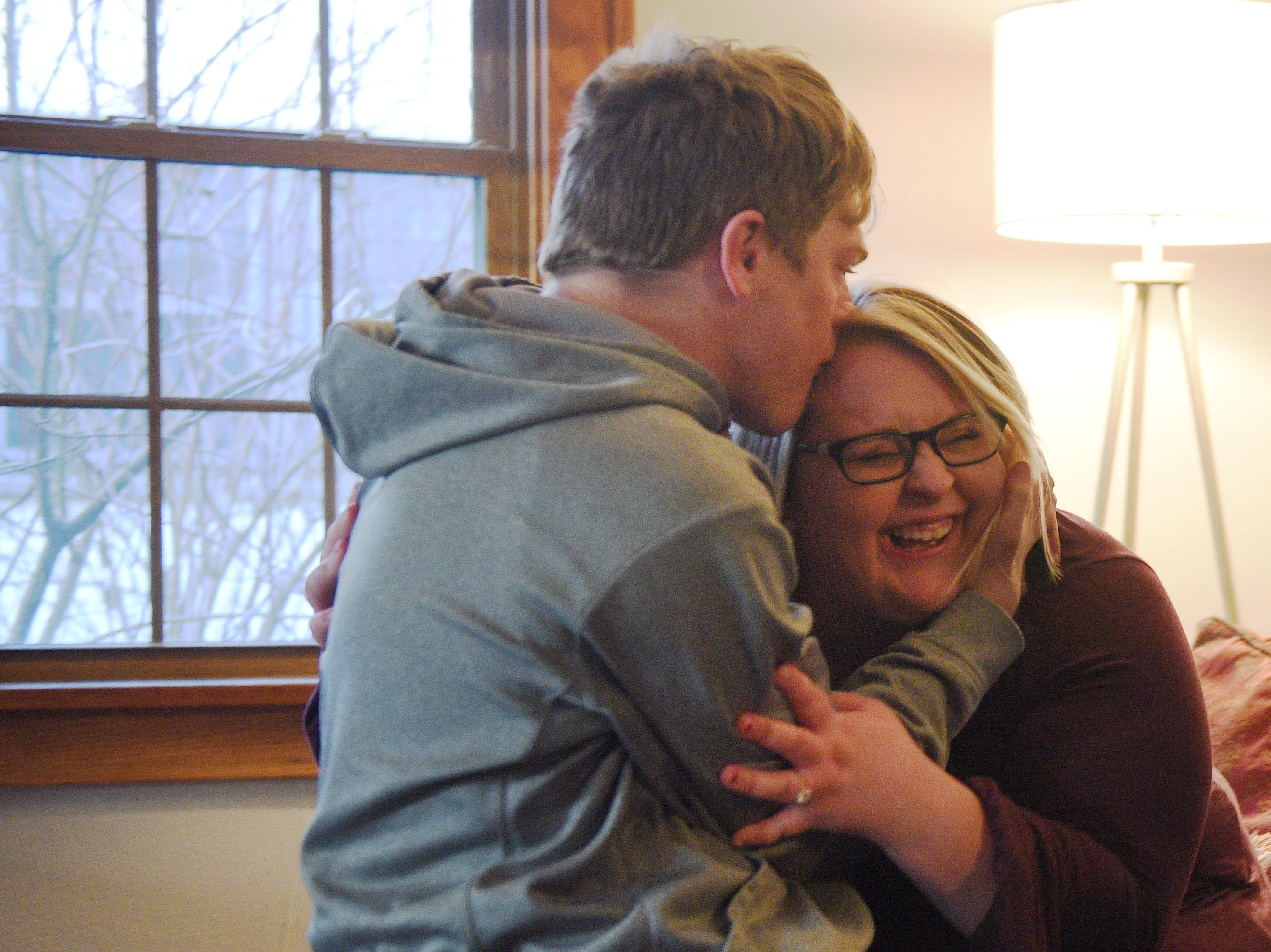 Ben Graff gives his roommate Jenna Askelson a kiss while having people over at his new house Wednesday, Nov. 7, in Sioux Falls. He lives with Shared Living Provider Kayla Harris and roommate Jenna Askelson.