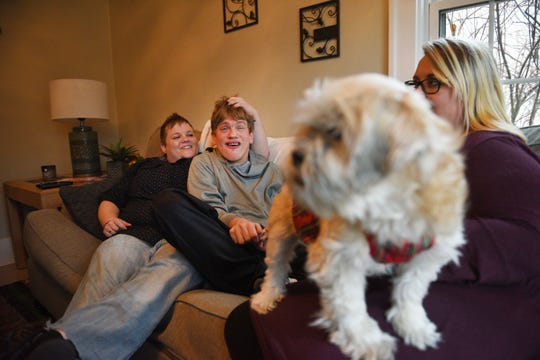 Ben Graff shows how he and his roommates watch TV in their new home Wednesday, Nov. 7, in Sioux Falls. He lives with Shared Living Provider Kayla Harris and roommate Jenna Askelson.
