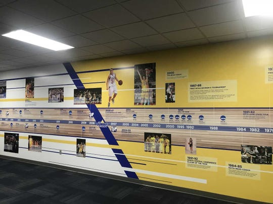 SDSU women's basketball history is documented on the wall leading to the practice facility