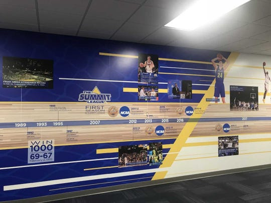 SDSU men's basketball history on the wall leading to the practice gym