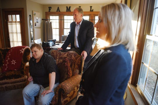 Shared Living Provider Kayla Harris, from left, Neil Graff and his wife Debbie Graff visit their son Ben's new home Wednesday, Nov. 7, in Sioux Falls. Ben is able to live by himself with the assistance of Shared Living Provider Kayla Harris and roommate Jenna Askelson.