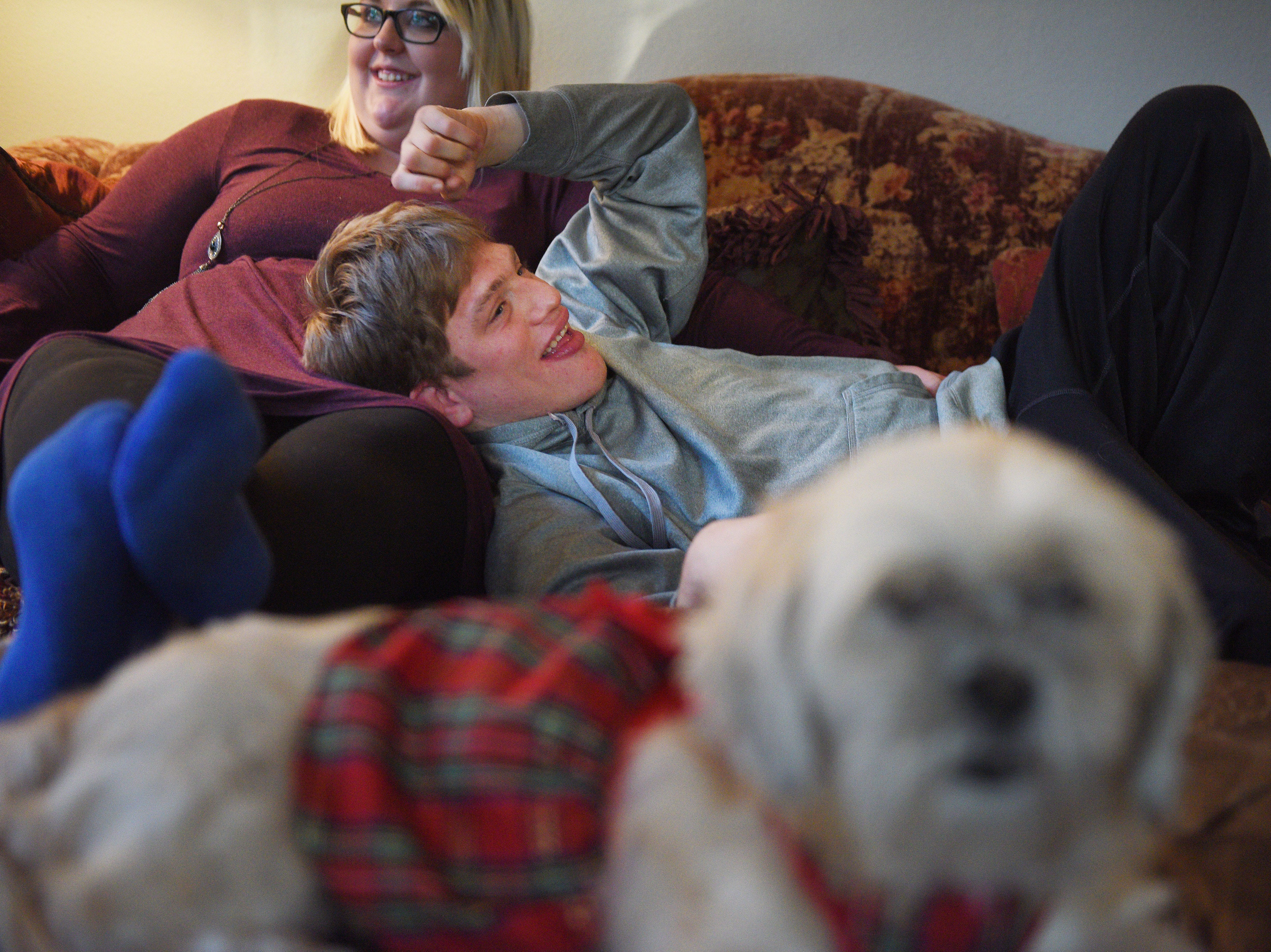 Ben Graff hangs out at his new house with his roommate Jenna Askelson and Chu Chi Wednesday, Nov. 7, in Sioux Falls. He lives with Shared Living Provider Kayla Harris and Askelson.