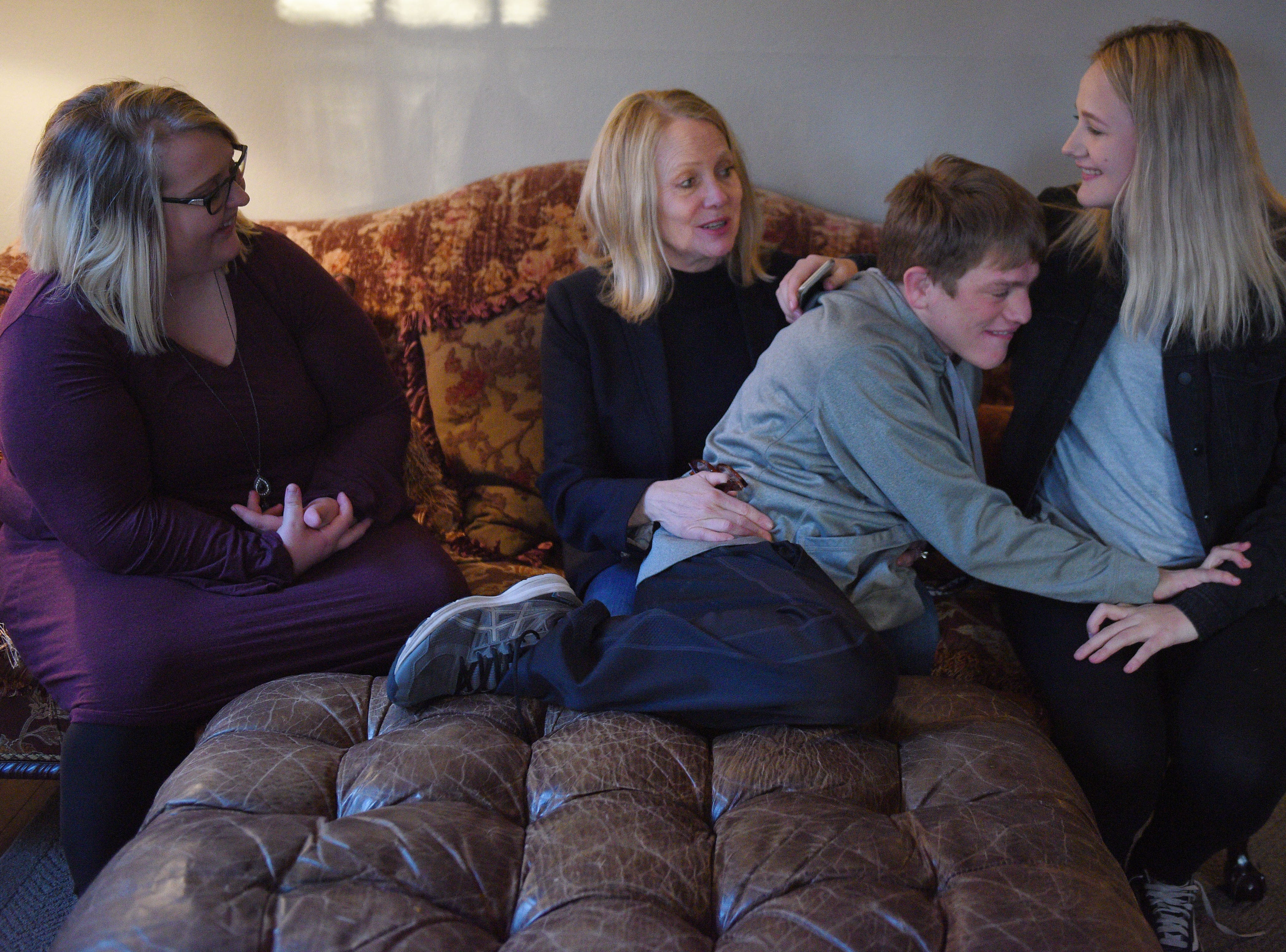 Jenna Askelson, Debbie Graff, Ben Graff and Elizabeth Graff visit Ben and Askelson's new house Wednesday, Nov. 7, in Sioux Falls. Ben is able to live by himself with the assistance of Shared Living Provider Kayla Harris and roommate Jenna Askelson.