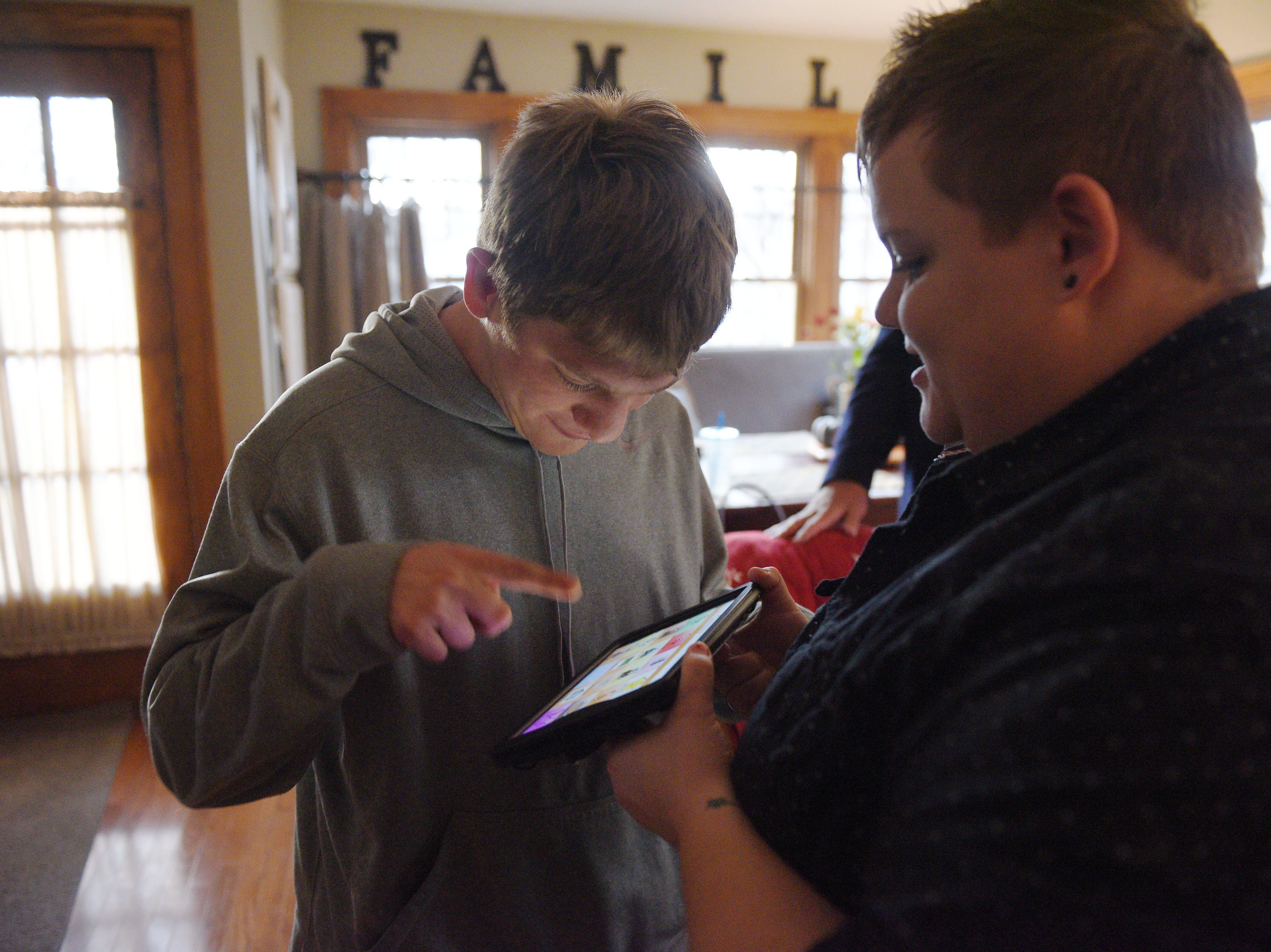 Ben Graff uses a Wego speech-generating device with the help of Shared Living Provider Kayla Harris at his new house Wednesday, Nov. 7, in Sioux Falls. Graff can use the communication device to say what he wants to eat, how he is feeling and introduce himself.