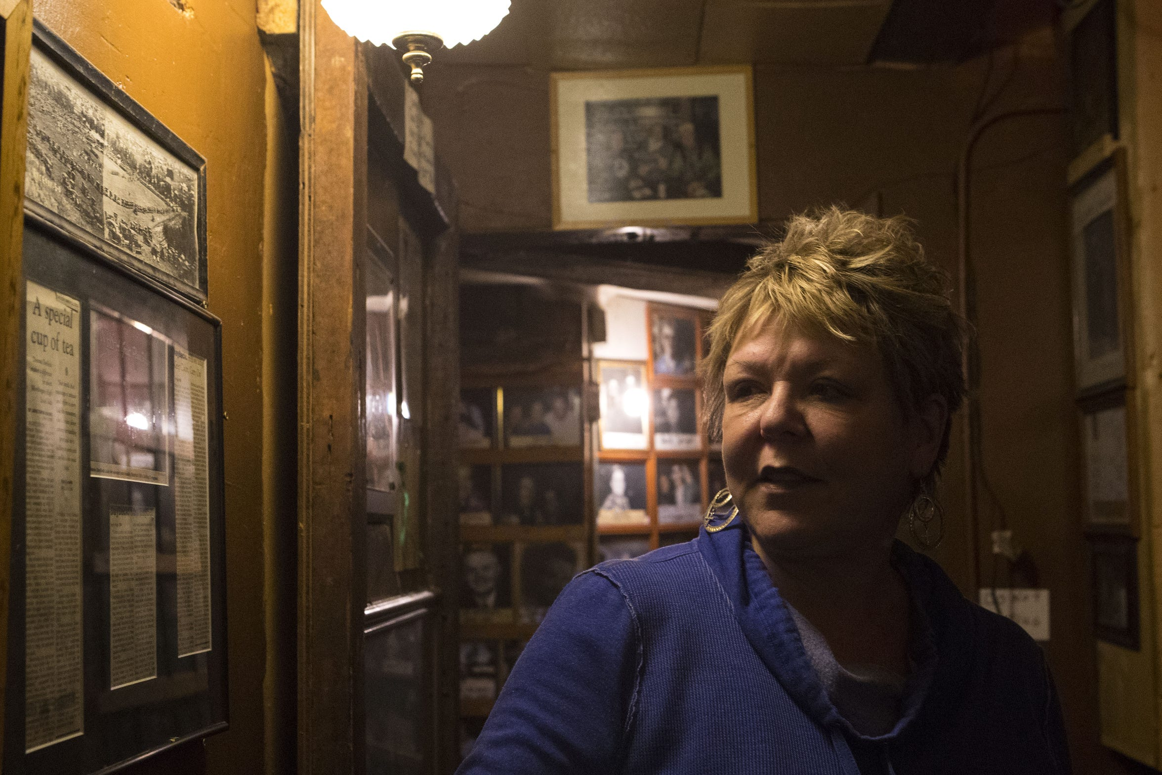 Shelly Day, owner of Frank Day's Bar and Restaurant in Dallas, S.D. talks about the many cowboy boots, framed photos of visitors and artifacts that line the walls of the bar.