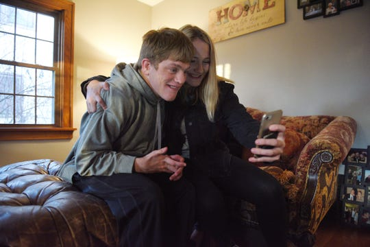 """Elizabeth Graff, who Ben calls """"Lala"""" comes by her brother Ben Graff's new house to visit Wednesday, Nov. 7, in Sioux Falls. Ben is able to live by himself with the assistance of Shared Living Provider Kayla Harris and roommate Jenna Askelson."""