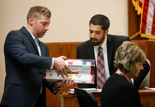 """Prosecutor Nathan Chapman, left, presents the knife to Aaron Exner, right, who worked in the crime lab of the Missouri State Highway Patrol, during the trial of Nicholas Godejohn, who is charged with first-degree murder in the June 2015 killing of 48-year-old Clauddine """"Dee Dee"""" Blanchard."""