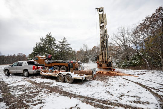 Workers from Southwest Missouri Well Drilling Inc. drill a hole to vent trichloroethylene (TCE) vapors at Fantastic Caverns. Many property owners in the area sought free well testing after the TCE issue was made public.