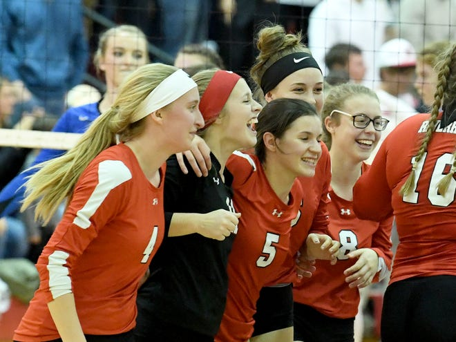 Riverheads' players celebrate their win as they defeat Mathews High School in three sets to win their VHSL Class 1 state semi finals match, played in Greenville on Tuesday, Nov. 13, 2018.