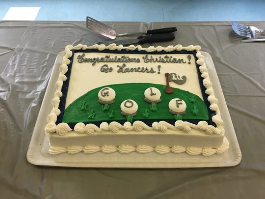 A cake celebrating Christian Michael's decision to attend Longwood was ready for his family and friends following a ceremony Wednesday. Michael, a senior at Fort Defiance, will play golf for the Lancers starting next season.