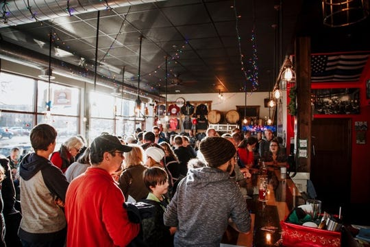 Shoppers participate in last year's Shop Small Crawl at Bad Habit Brewing Co. in St. Joseph.