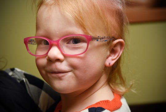 Lizzy Gerads smiles after having her ears pierced pierced Wednesday, Nov. 14, at Sartell Pediatrics.