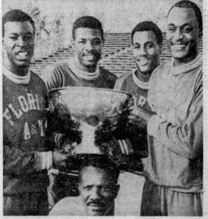 From left to right: Eugene Milton, Nathaniel James, James Ashcroft and Major Hazleton pose with the J.C. Patterson Cup. Below is former head coach Bobby Lang.