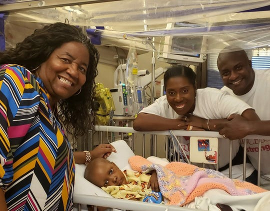 Two-year-old Jae Alexia Jackson with her parents Dee and Clarence Jackson (right)