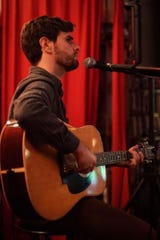 T.J. Washburn brings his guitar Wednesday at Blue Tavern after Stories at Blue