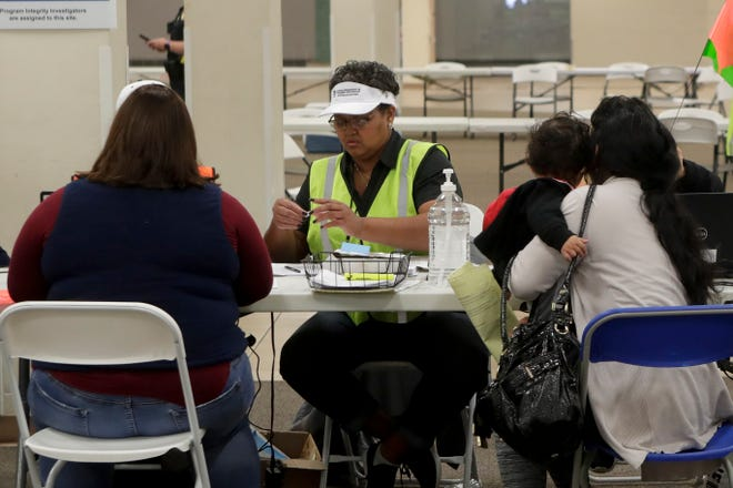 Clients get help signing up for the Disaster Food Assistance Program (DSNAP) at The Centre of Tallahassee Wednesday, Nov. 14, 2018.